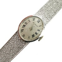 Montre dame or blanc